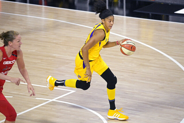 FILE - In this Sept. 10, 2020, file photo, Los Angeles Sparks forward Candace Parker (3) brings the ball up next to Washington Mystics guard Emma Meesseman during the second half of a WNBA basketball game in Bradenton, Fla. WNBA free agents can't officially sign until Monday, but Parker is leaving for the Chicago Sky after playing the first 13 years of her professional career with the Sparks, according to a person familiar with decision. The person spoke to the AP on condition of anonymity Wednesday, Jan. 27, because no official announcement is allowed until Feb. 1. (AP Photo/Phelan M. Ebenhack, File)
