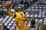 FILE - In this Feb. 23, 2021, file photo, West Virginia forward Derek Culver (1) goes up to shoot as TCU's Jaedon LeDee defends in the first half of an NCAA college basketball game in Fort Worth, Texas. Culver is a member of The AP All-Big 12 first team, announced Tuesday, March 9, 2021. (AP Photo/Tony Gutierrez, File)