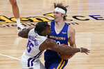 Sacramento Kings rookie guard Davion Mitchell, left, fouls Golden State Warriors forward Nick Mayo during the second half of a California Classic NBA summer league basketball game in Sacramento, Calif., Tuesday, Aug. 3, 2021. (AP Photo/Rich Pedroncelli)
