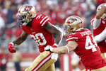 San Francisco 49ers running back Jeff Wilson Jr. (30) celebrates with fullback Kyle Juszczyk (44) after scoring against the Arizona Cardinals during the second half of an NFL football game in Santa Clara, Calif., Sunday, Nov. 17, 2019. (AP Photo/Josie Lepe)