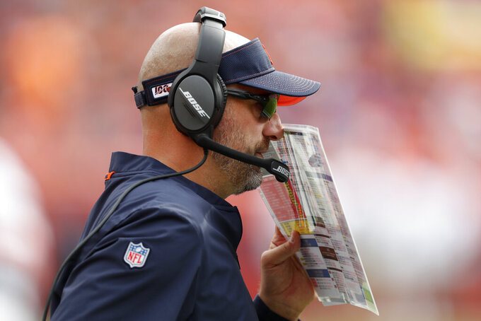 Chicago Bears head coach Matt Nagy makes a call against the Denver Broncos during the first half of an NFL football game, Sunday, Sept. 15, 2019, in Denver. (AP Photo/David Zalubowski)