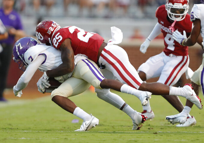 Oklahoma defensive back Justin Broiles (25) tackles Western Carolina wide receiver Terrence Horne (7) during the first half of an NCAA college football game Saturday, Sept. 11, 2021, in Norman, Okla. (AP Photo/Alonzo Adams)