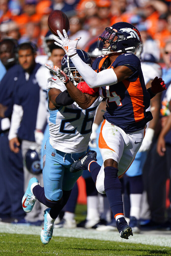 Denver Broncos wide receiver Courtland Sutton, right, hauls in a pass as Tennessee Titans cornerback Logan Ryan defends during the first half of an NFL football game Sunday, Oct. 13, 2019, in Denver. (AP Photo/Jack Dempsey)