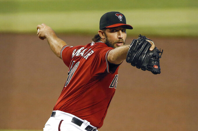 Arizona Diamondbacks' Madison Bumgarner delivers a pitch against the Colorado Rockies during the first inning of a baseball game Sunday, Sept. 27, 2020, in Phoenix. (AP Photo/Darryl Webb)