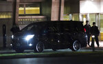 A vehicle with former Nissan Chairman Carlos Ghosn on board leaves the Tokyo Detention Center, in Tokyo Thursday, April 25, 2019. Former Nissan Chairman Carlos Ghosn walked out of detention Thursday evening, his head held high, after a Japanese court rejected an appeal from prosecutors and his 500 million yen ($4.5 million) in bail was paid earlier in the day. (AP Photo/Eugene Hoshiko)