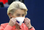 European Commission President Ursula von der Leyen puts on her protective face mask after delivering a State of the Union Address at the European Parliament in Strasbourg, France, Wednesday, Sept. 15, 2021. Stung by the swift collapse of the Afghan army and the chaotic U.S.-led evacuation through Kabul airport, the European Union on Wednesday unveiled new plans to develop its own defense capacities to try to ensure that it has more freedom to act in future crises. (Yves Herman, Pool via AP)