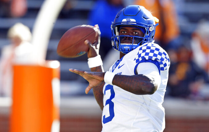 Kentucky quarterback Terry Wilson (3) warmups before an NCAA college football game against Tennessee Saturday, Nov. 10, 2018, in Knoxville, Tenn. (AP Photo/Wade Payne)