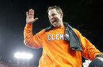 FILE - In this Jan. 10, 2017, file photo, Clemson head coach Dabo Swinney celebrates defeating Alabama 35-31 in the NCAA college football playoff championship game, in Tampa, Fla. Swinney has agreed to the biggest contract in college football history, paying him $92 million over the next 10 years. Trustees approved the contract Friday, April 26, 2019, which runs through 2028. (AP Photo/David J. Phillip, File)