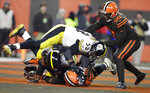 Cleveland Browns defensive end Myles Garrett (95), Pittsburgh Steelers center Maurkice Pouncey (53) and offensive guard David DeCastro (66) fight during the second half of an NFL football game, Thursday, Nov. 14, 2019, in Cleveland. The Browns won 21-7. (AP Photo/Ron Schwane)
