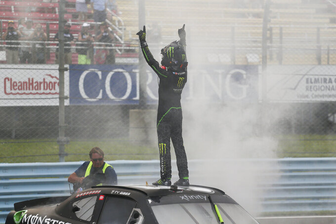 Ty Gibbs, top, celebrates after winning a NASCAR Xfinity Series auto race at Watkins Glen International in Watkins Glen, N.Y., on Saturday, Aug. 7, 2021. (AP Photo/Joshua Bessex)