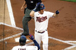 Minnesota Twins' Max Kepler pats his head as he scores on his two-run home run off Chicago White Sox pitcher Dylan Cease in the second inning of a baseball game, Monday, July 5, 2021, in Minneapolis. (AP Photo/Jim Mone)