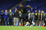 LSU offensive lineman Saahdiq Charles runs a drill at the NFL football scouting combine in Indianapolis, Friday, Feb. 28, 2020. (AP Photo/Michael Conroy)