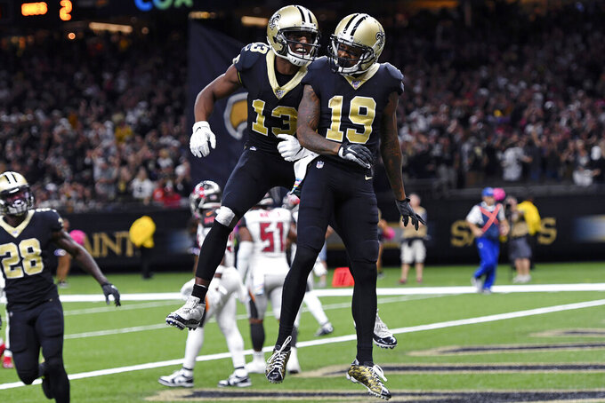 New Orleans Saints wide receiver Ted Ginn (19) celebrates his touchdown reception with wide receiver Michael Thomas (13) in the second half of an NFL football game against the Tampa Bay Buccaneers in New Orleans, Sunday, Oct. 6, 2019. (AP Photo/Bill Feig)