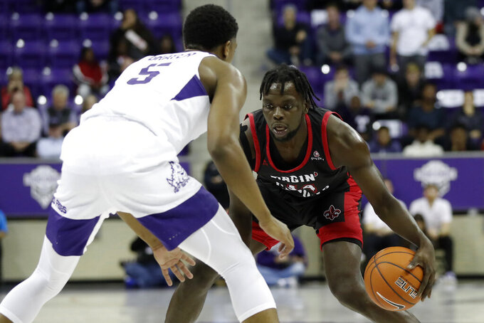 TCU guard Jaire Grayer (5) defends against Louisiana-Lafayette forward Dou Gueye during the first half of an NCAA college basketball game in Fort Worth, Texas, Tuesday, Nov. 12, 2019. (AP Photo/Tony Gutierrez)