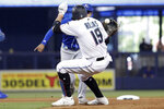 Miami Marlins' Miguel Rojas (19) is tagged out by Kansas City Royals second baseman Nicky Lopez during the fourth inning of a baseball game Sunday, Sept. 8, 2019, in Miami. (AP Photo/Lynne Sladky)