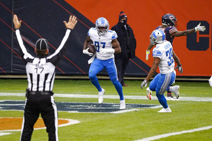 Detroit Lions wide receiver Quintez Cephus (87) celebrates after a touchdown against the Chicago Bears in the first half of an NFL football game in Chicago, Sunday, Dec. 6, 2020. (AP Photo/Charles Rex Arbogast)