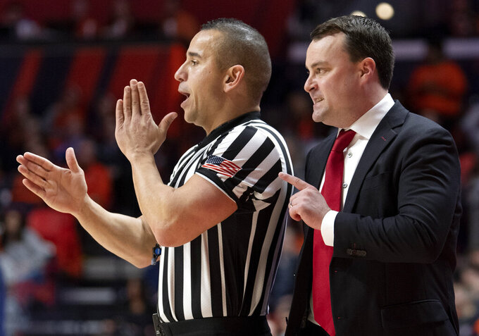 Indiana coach Archie Miller questions a call during the first half of the team's NCAA college basketball game against Illinois in Champaign, Ill., Thursday, March 7, 2019. (AP Photo/Stephen Haas)
