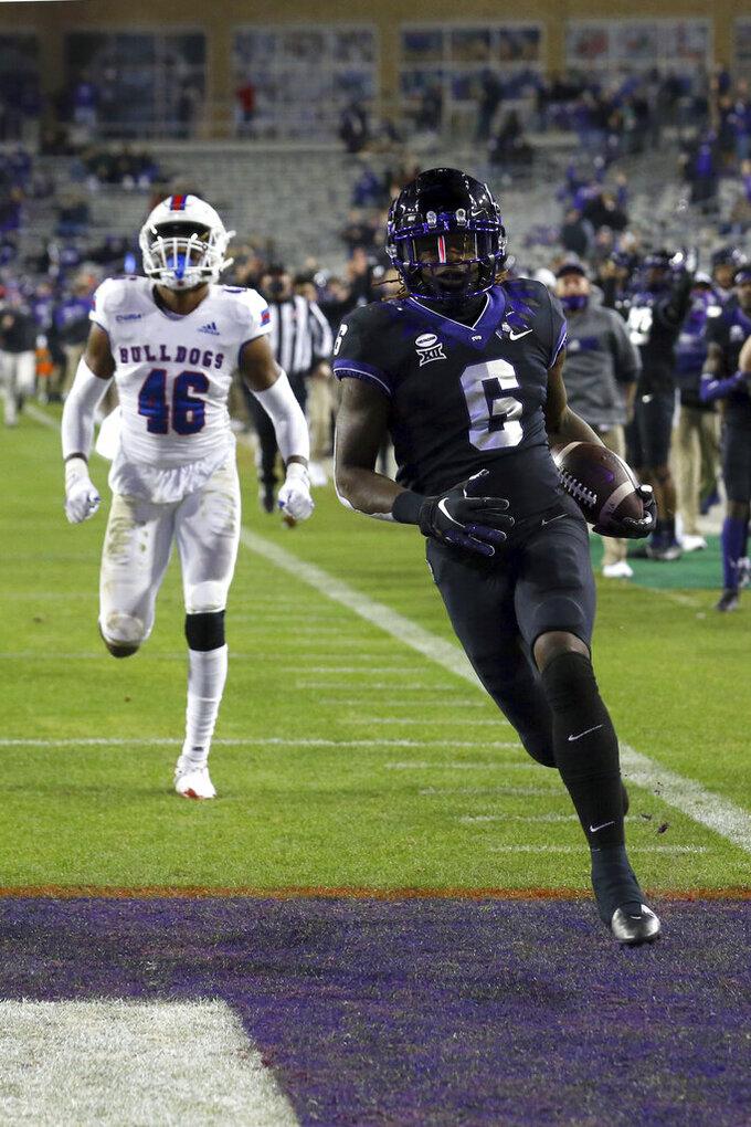 Louisiana Tech linebacker Ezekiel Barnett (46) pursues TCU running back Zach Evans (6) who scores a touchdown run in the third quarter during an NCAA college football game, Saturday, Dec. 12, 2020. (AP Photo/ Richard W. Rodriguez)