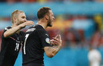 Austria's Marko Arnautovic, right, celebrates after scoring his side's third goal during the Euro 2020 soccer championship group C match between Austria and Northern Macedonia at the National Arena stadium in Bucharest, Romania, Sunday, June 13, 2021. (Robert Ghement/Poolvia AP)
