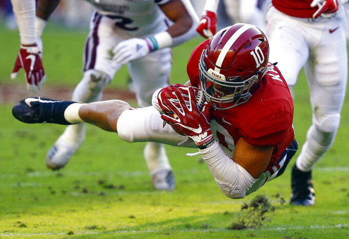 Alabama linebacker Ale Kaho (10) recovers a punt bobbled by Mississippi State wide receiver Deddrick Thomas (2) during the first half of an NCAA college football game, Saturday, Nov. 10, 2018, in Tuscaloosa, Ala. (AP Photo/Butch Dill)