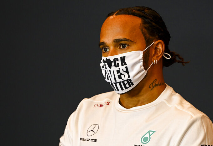 Mercedes driver Lewis Hamilton of Britain wears a protective face mask as he attends a media conference ahead of Sunday's Emilia Romagna Formula One Grand Prix, at the Enzo and Dino Ferrari racetrack, in Imola, Italy, Friday, Oct. 30, 2020. (Mark Sutton, Pool via AP)