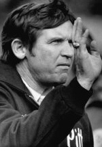 FILE - In this 1976 file photo, Pittsburgh NCAA college football head coach Johnny Majors gestures from the sideline during a college football game in Pittsburgh. Majors, the coach of Pittsburgh's 1976 national championship team and a former coach and star player at Tennessee, has died. He was 85. Majors died Wednesday morning, June 3, 2020, at home in Knoxville, Tenn., according to a statement from his wife, Mary Lynn Majors.(AP Photo/Harry Cabluck, File)