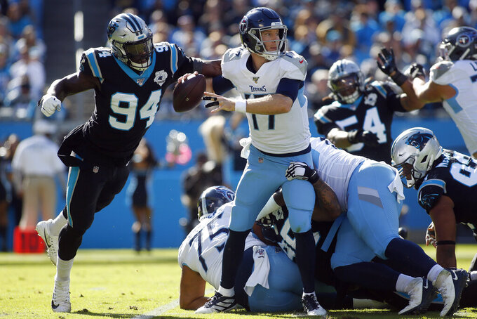 Carolina Panthers defensive end Efe Obada (94) rushes Tennessee Titans quarterback Ryan Tannehill (17) during the first half of an NFL football game in Charlotte, N.C., Sunday, Nov. 3, 2019. (AP Photo/Brian Blanco)