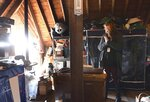 In this Wednesday, Feb. 27, 2019 photo, Sibley County Historical Society executive director Amy Newsom looks at an attic full of items that are part of the museum's collection in Henderson, Minn. (Pat Christman/The Free Press via AP)