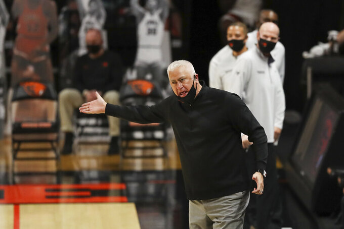 Oregon State head coach Wayne Tinkle gives instructions to players during the second half of an NCAA college basketball game against Colorado in Corvallis, Ore., Saturday, Feb. 20, 2021. (AP Photo/Amanda Loman)