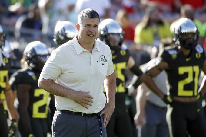 FILE - Oregon head coach Mario Cristobal watches during warm ups before the Rose Bowl NCAA college football game against Wisconsin, in Pasadena, Calif., in this Wednesday, Jan. 1, 2020, file photo. The National Signing Day period begins Wednesday, Feb. 3, 2021. (AP Photo/Marcio Jose Sanchez, File)