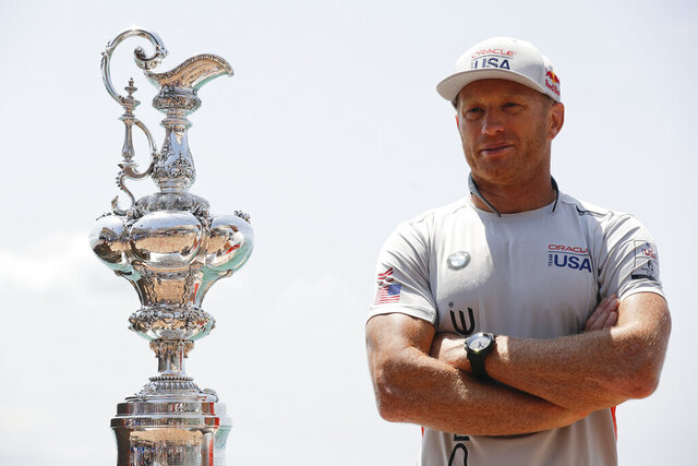 FILE - In this June 16, 2017, file photo, Oracle Team USA skipper and helmsman Jimmy Spithill stands alongside the America's Cup trophy, known as the