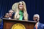 Businesswoman Kelly Loeffler speaks after she was introduced by Georgia Gov. Brian Kemp as his pick to fill Georgia's vacant U.S. Senate seat at the Georgia State Capitol on Wednesday, Dec. 4, 2019, in Atlanta. (AP Photo/Elijah Nouvelage)