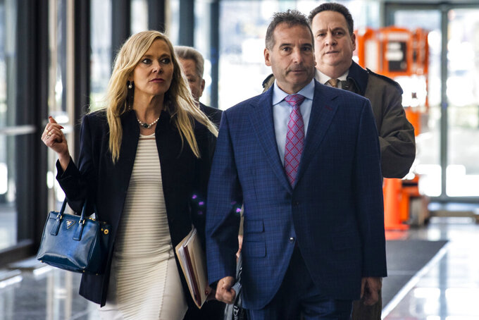 Vincent DelGiudice, right, along with his attorney, Carolyn Gurland, walk out of the Dirksen Federal Courthouse, Wednesday morning, March 4, 2020. Federal prosecutors say DelGiudice is among 10 people charged with operating an offshore sports gambling business. (Ashlee Rezin Garcia/Chicago Sun-Times via AP)