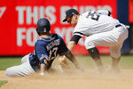 San Diego Padres' Manny Machado (13) slides safely into second base against New York Yankees second baseman DJ LeMahieu, right, during the ninth inning of an baseball game, Monday, May 27, 2019, in New York. (AP Photo/Michael Owens)