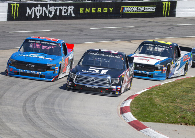 Kyle Busch passes pole sitter Stewart Friesen for the lead during the NASCAR Gander Outdoors Truck Series race at Martinsville Speedway in Martinsville, Va. Saturday, March 23, 2019. (AP Photo/Matt Bell)