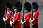 Members of the Welsh Guards perform in a ceremony to mark the official birthday of Britain's Queen Elizabeth II, at Windsor Castle in Windsor, England, Saturday June 13, 2020. Queen Elizabeth II's birthday is being marked with a smaller ceremony than usual this year, as the annual Trooping the Color parade is canceled amid the coronavirus pandemic. The Queen celebrates her 94th birthday this year. (Toby Melville/Pool via AP)