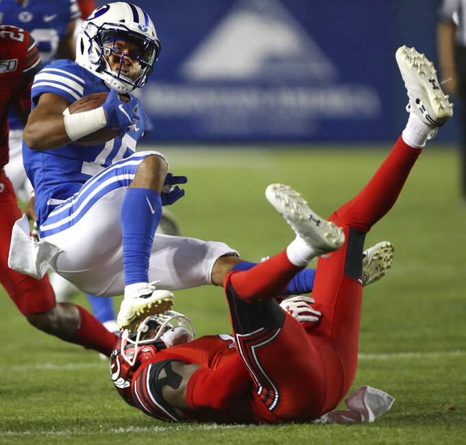 BYU wide receiver Aleva Hifo (15) is upended by Utah defensive back Jaylon Johnson (1) in the first half during an NCAA college football game, Thursday, Aug. 29, 2019, in Provo, Utah. (AP Photo/George Frey)