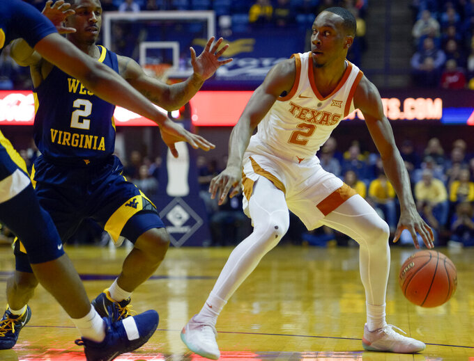 Texas guard Matt Coleman III (2) maneuvers during the first half of an NCAA college basketball game against West Virginia in Morgantown, W.Va., Saturday, Feb. 9, 2019. (AP Photo/Craig Hudson)