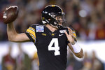 Iowa quarterback Nate Stanley looks to throw a pass during the first half of the Holiday Bowl NCAA college football game against Southern California, Friday, Dec. 27, 2019, in San Diego. (AP Photo/Orlando Ramirez)
