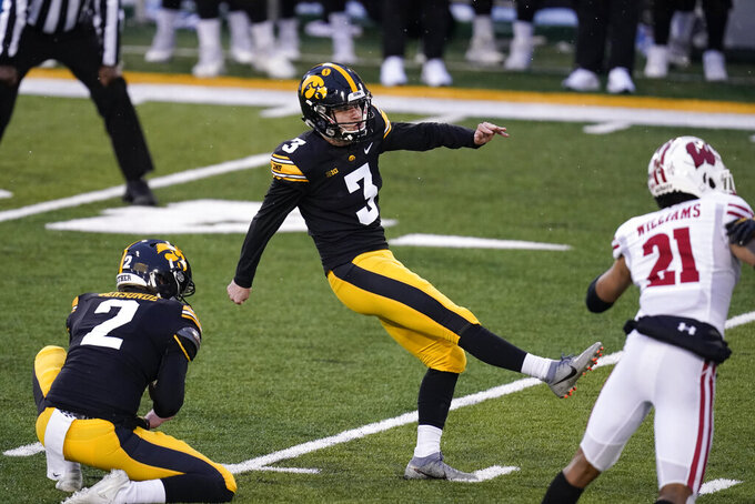 Iowa place kicker Keith Duncan (3) kicks a 45-yard field goal during the first half of an NCAA college football game against Wisconsin, Saturday, Dec. 12, 2020, in Iowa City, Iowa. (AP Photo/Charlie Neibergall)