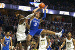 Wake Forest forward Isaiah Mucius (1) defends Duke forward Wendell Moore Jr. (0) shot in double overtime of an NCAA college basketball game Tuesday, Feb. 25, 2020, in Winston-Salem, N.C. (AP Photo/Lynn Hey)
