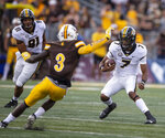 Missouri quarterback Kelly Bryant (7) runs the ball against Wyoming in the first quarter of an NCAA college football game Saturday, Aug. 31, 2019, in Laramie, Wy. (AP Photo/Michael Smith)