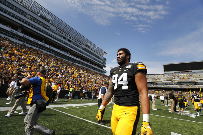 Iowa defensive end A.J. Epenesa walks off the field following the Hawkeyes 30-0 win over Rutgers in an NCAA college football game, Saturday, Sept. 7, 2019, in Iowa City. (AP Photo/Matthew Putney)
