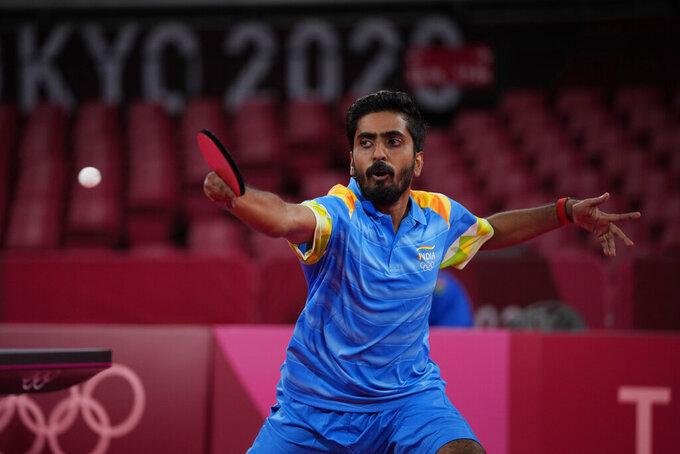 Sathiyan Gnanasekaran of India competes during the table tennis men's singles second round match against Lam Siu Hang of Hong Kong at the 2020 Summer Olympics, Sunday, July 25, 2021, in Tokyo. (AP Photo/Kin Cheung)