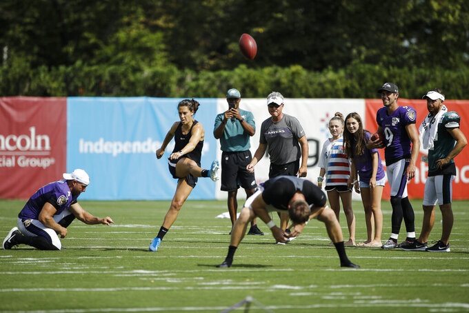 United States soccer player Carli Lloyd attempts to kick a field goal after the Philadelphia Eagles and the Baltimore Ravens held a joint NFL football practice in Philadelphia, Tuesday, Aug. 20, 2019. (AP Photo/Matt Rourke)