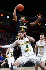 Northern Kentucky forward Dantez Walton (32) drives on Wright State guard Alan Vest (4) during the second half of an NCAA college basketball game for the Horizon League men's tournament championship in Detroit, Tuesday, March 12, 2019. (AP Photo/Paul Sancya)