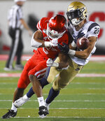 Navy wide receiver Keoni-Kordell Makekau, right, is hit by Houston cornerback Damarion Williams during the second half of an NCAA college football game, Saturday, Nov. 30, 2019, in Houston. (AP Photo/Eric Christian Smith)