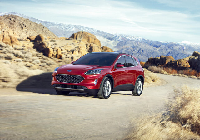 This undated photo provided by Ford shows the 2020 Ford Escape. The vehicle is as an example of how the redesigned version of a vehicle offers a number of improvements that might be worth the added price. (David Westphal/Ford Motor Co. via AP)