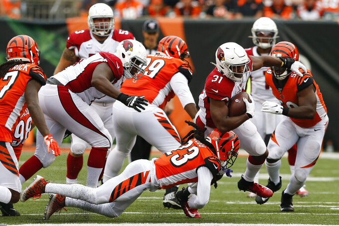 Arizona Cardinals running back David Johnson (31) runs the ball against Cincinnati Bengals cornerback B.W. Webb (23) in the second half of an NFL football game, Sunday, Oct. 6, 2019, in Cincinnati. (AP Photo/Gary Landers)