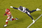 Kansas City Chiefs running back Clyde Edwards-Helaire (25) scores a touchdown on a 27-yard run ahead of Houston Texans linebacker Jacob Martin (54) in the second half of an NFL football game Thursday, Sept. 10, 2020, in Kansas City, Mo. (AP Photo/Charlie Riedel)